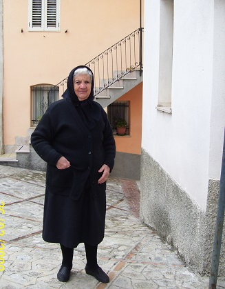 an elderly lady dressed in black