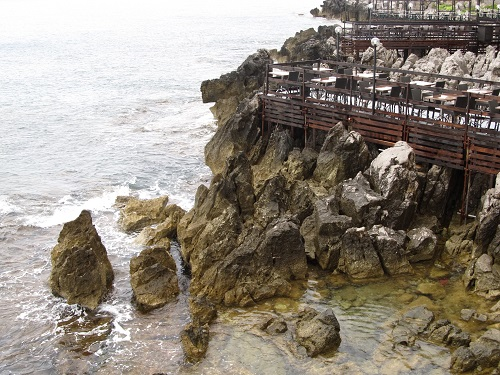 restaurants surrounded by rocks and sea