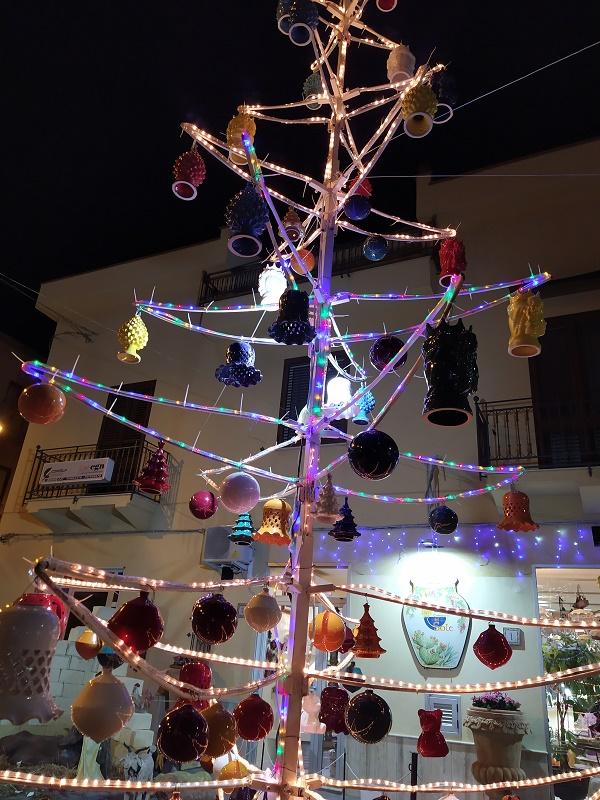 A Christmas tree full of ceramic pine cones