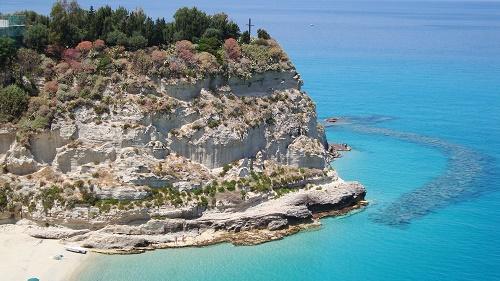 Limestone rocks in Tropea with beautiful turquoise blue sea