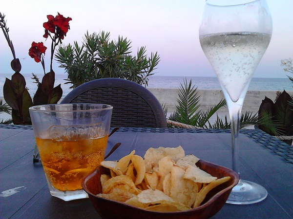 A glass of prosecco and crodino in a seafront bar in Calabria