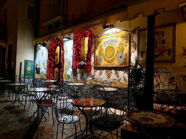 A bar with a ceramic wall panel in Taormina
