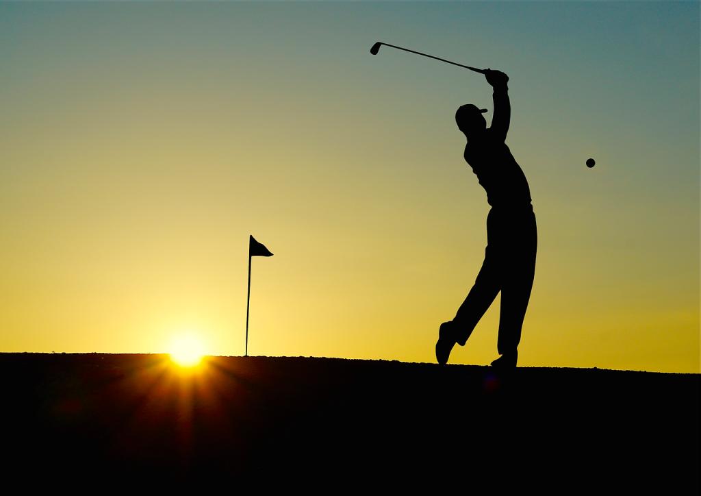 Playing golf at sunset